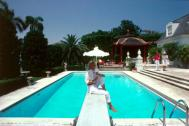 Slim Aarons Poolside - Pool And Parasol